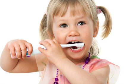 Close up portrait of little girl brushing teeth.Isolated on white background.